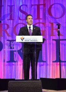 October 22, 2015-- New York City -- Governor Andrew M. Cuomo receives the Silver Torch Award from Lady Gaga's mother, Cynthia Germanottam at the Empire State Pride Agenda Fall Dinner at the Sheraton New York Times Square Hotel Thursday October 22, 2015. During his acceptance speech, Governor  Cuomo introduced regulations through the New York State Human Rights Law that unequivocally bans harassment and discrimination against transgender people. These regulations affirm that all transgender individuals are protected under the State's Human Rights Law, and all public and private employers, housing providers, businesses, creditors and others should know that discrimination against transgender persons is unlawful and will not be tolerated anywhere in the State of New York. (Kevin P. Coughlin/Office of the Governor)